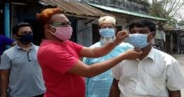 বাংলাদেশ মানবাধিকার কমিশনের উদ্যোগে বাগাতিপাড়ায় মাস্ক বিতরণ